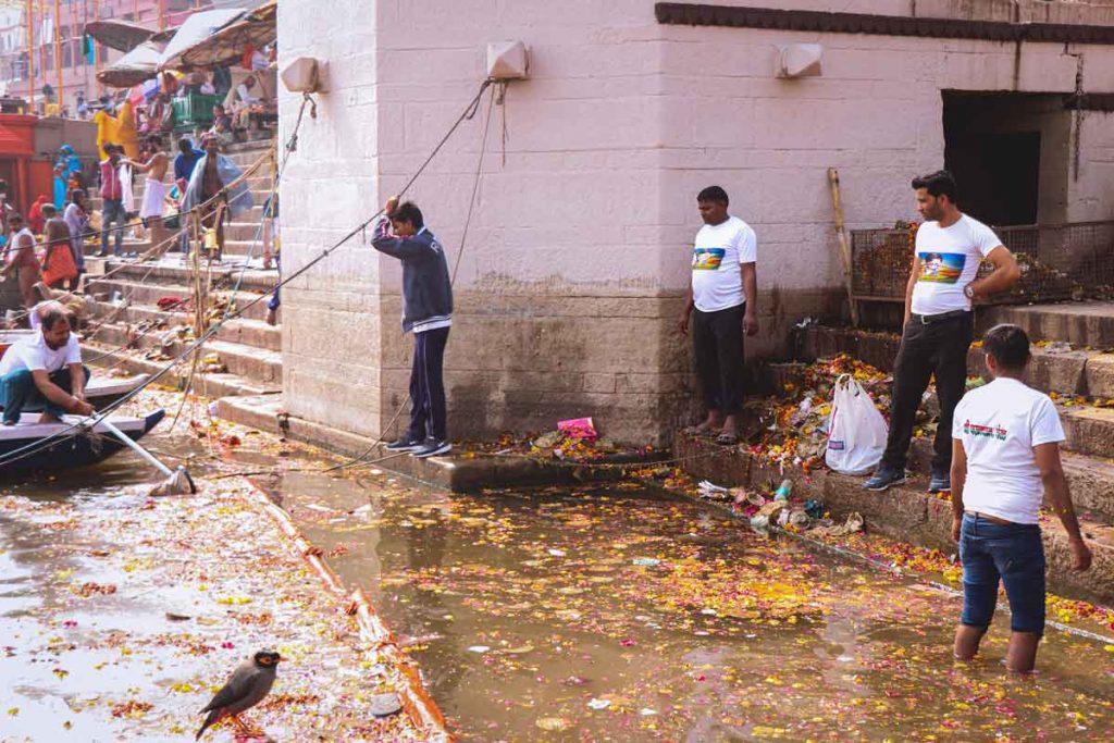 Volunteer to clean ghats in Varanasi